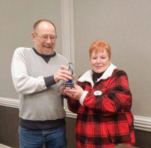 2020 Relentless Badger Award presented to Ken Arneson by Bobbi Craig