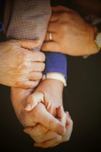 Image of several people holding hands